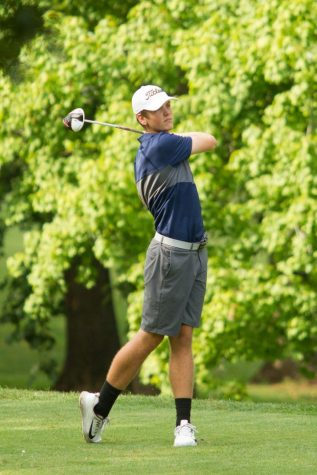 Junior Jack Kershner tees off in hope of winning his match. Photo courtesy of Fluvannaphotos.com