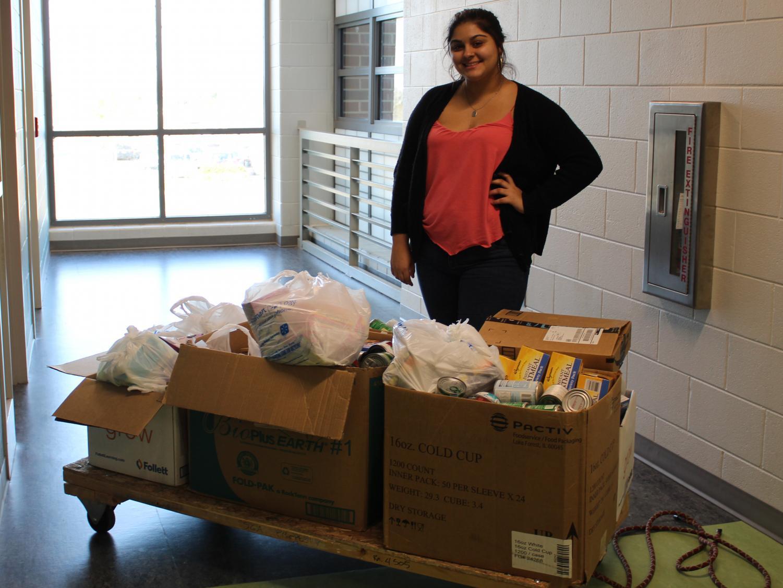 Kyandra Rivera-DeJesus with the Puerto Rico donations. Photo courtesy of Emily Antesberger