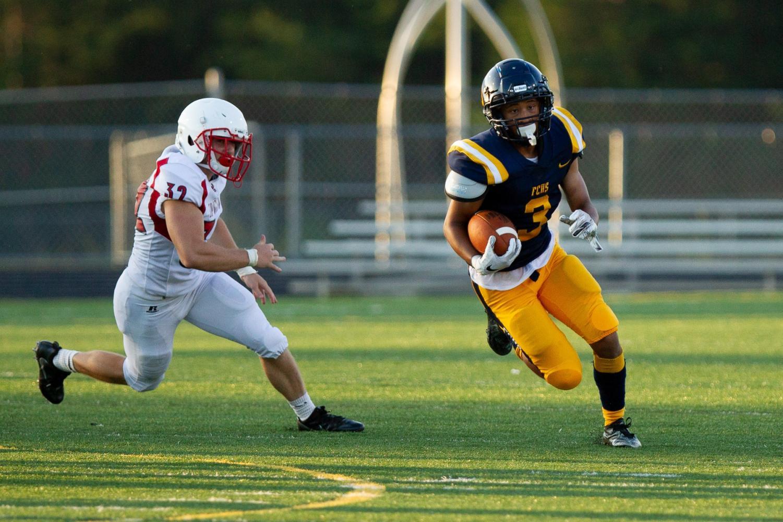 Cameron Holland makes a run at the Aug. 31 home game against Spotsylvania. Photo courtesy of Fluvanna Photos.