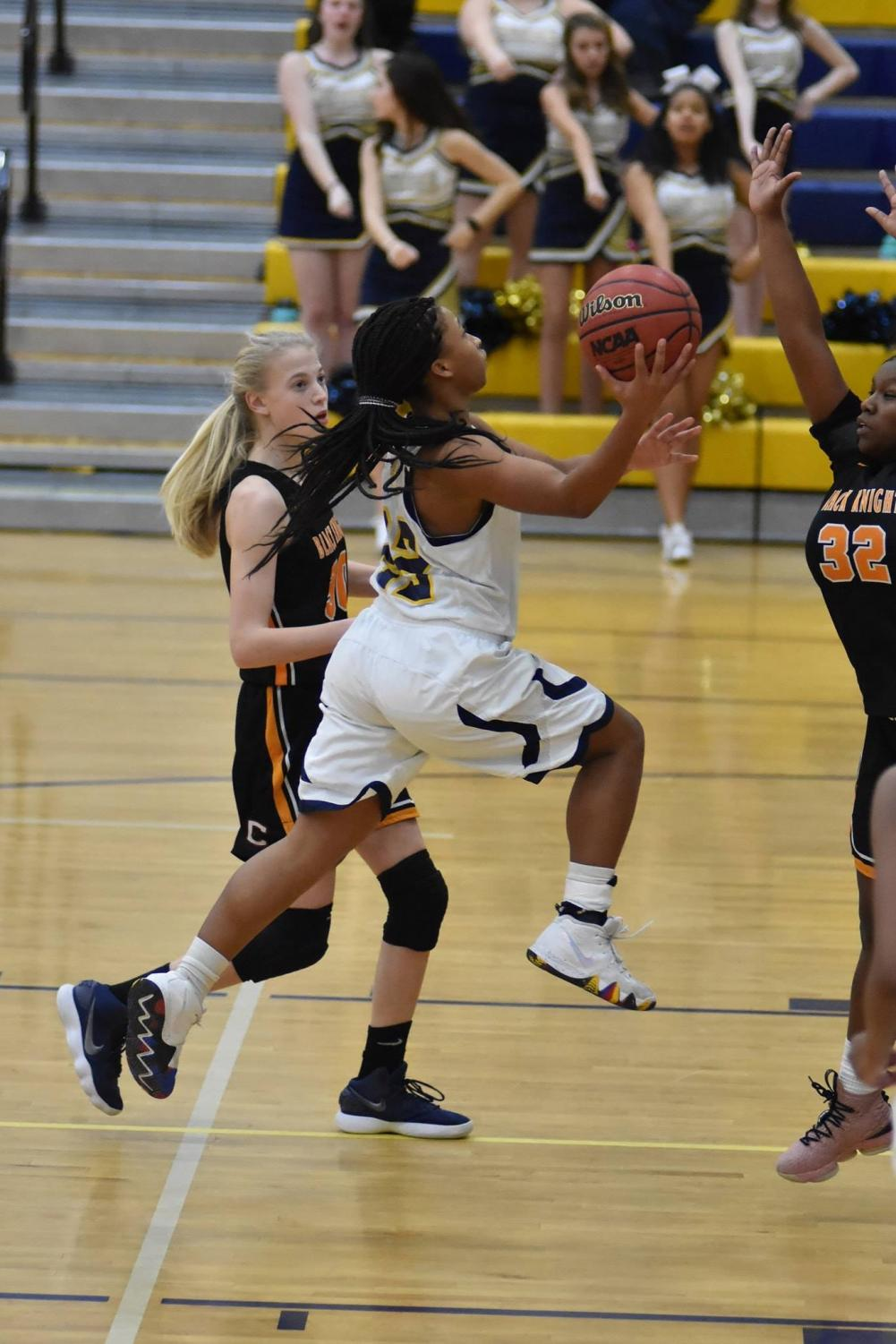 Varsity player Junior Jules Shepherd driving to the basket in the game against Charlottesville on Jan. 22. Photo courtesy of Flying Flucos Sports.