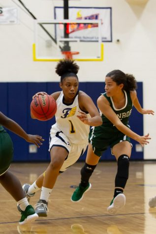 Junior Nevaeh Ivory driving up the court at the varsity game against W. Monroe on 11/30. Photo courtesy of Fluvanna Photos.