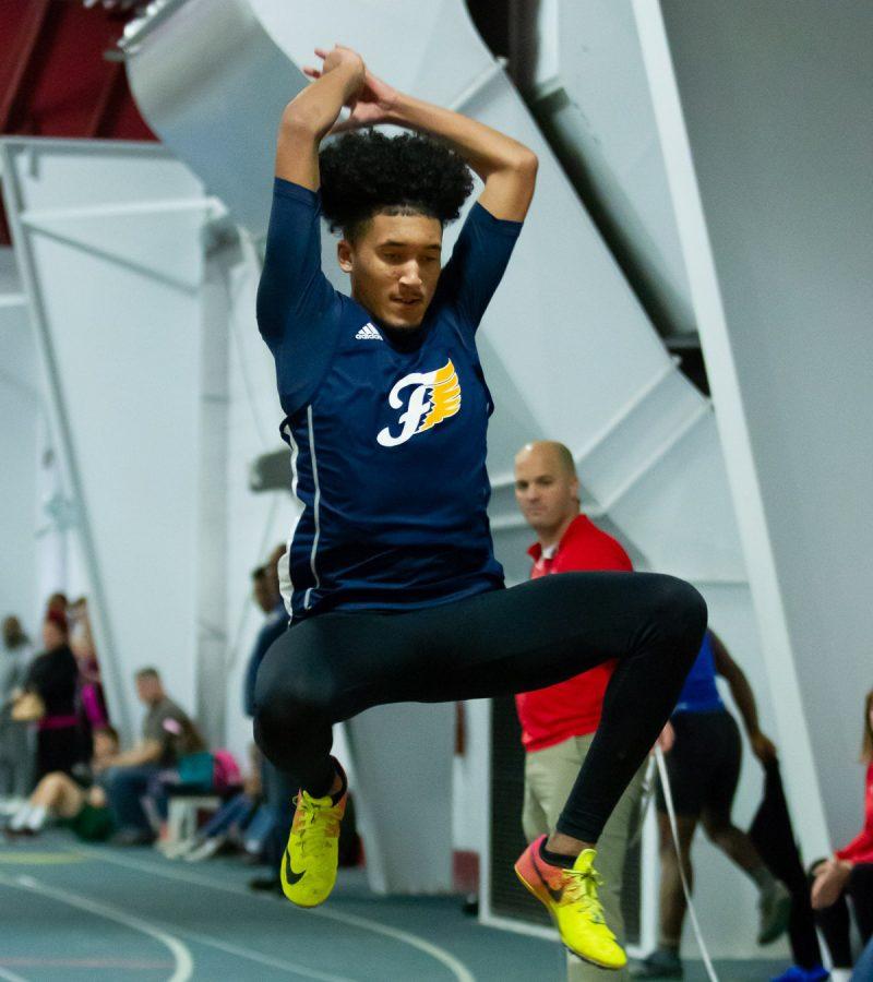 Senior+Christian+Holland+jumping+the+triple+jump+at+the+track+meet+on+Jan.+31.+Photo+courtesy+of+Fluvanna+Photos.++