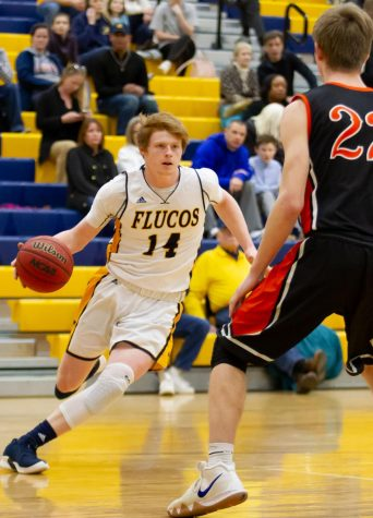 Senior Drew Pace driving to the basket at the Varsity game against Powhatan on 1/25. Photo courtesy of Fluvanna Photos.