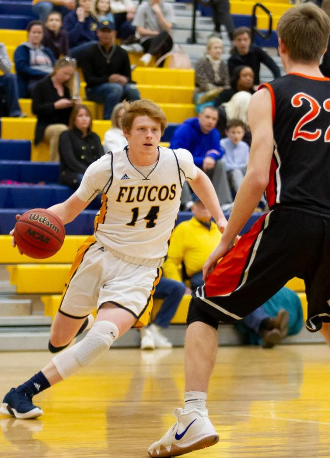 Senior+Drew+Pace+driving+to+the+basket+at+the+Varsity+game+against+Powhatan+on+1%2F25.+Photo+courtesy+of+Fluvanna+Photos.+