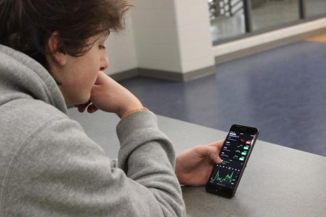 Junior Ethan Smialek keeping tabs on his stocks on the stock market. Photo courtesy of FCHS Journalism.