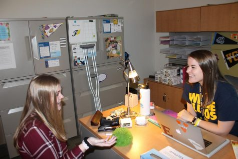 Ms. Allen talking to Natalie Branch. Photo courtesy of FCHS Journalism