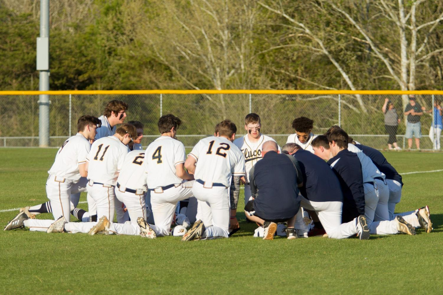 The 2017-18 Varsity Fluco Baseball team in a team huddle at the game against Louisa on 5/1/18.  Photo courtesy of Fluvanna photos.
