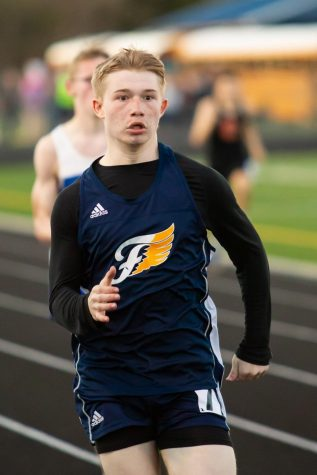 Sophomore Travis Morris running at the meet on 4/10. Photo courtesy of Fluvanna Photos.