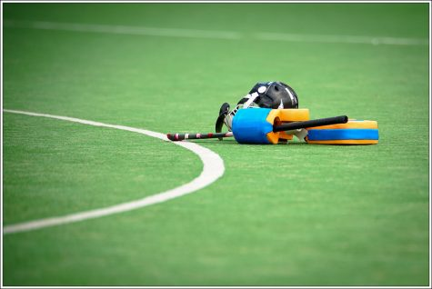 Stock photo of field hockey equipment. Photo courtesy of Flickr under Creative Commons License.