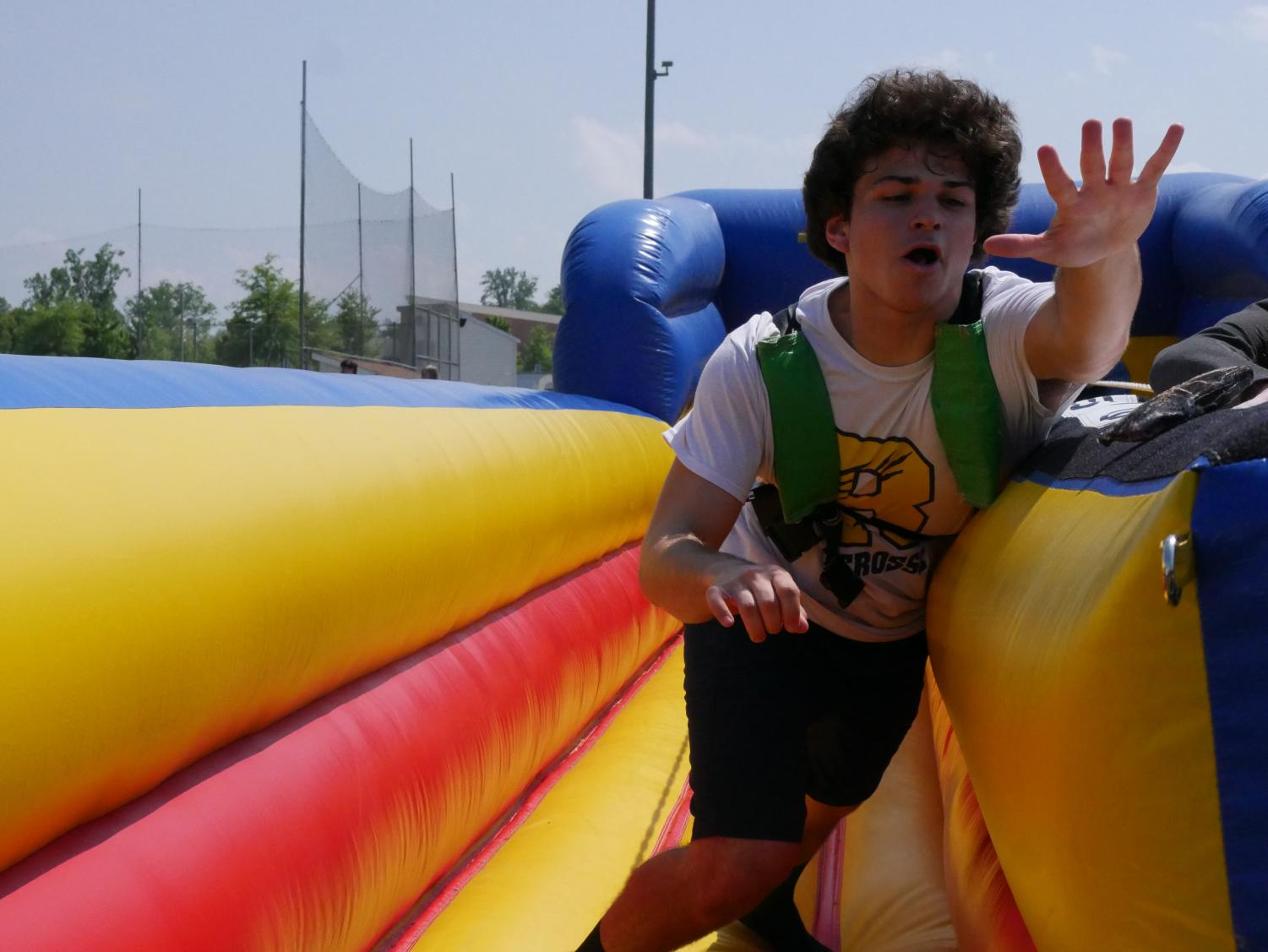Senior Ethan Vernatter fights to make it to the finish line in the bungee race at the Decision Day party on May 1. Photo courtesy of David Small.