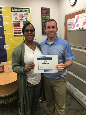 Mr. Pace receiving his Staff Member of the Month from Mrs. Bruce