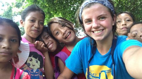 MaryAnn posing with some of the Guatemalan children