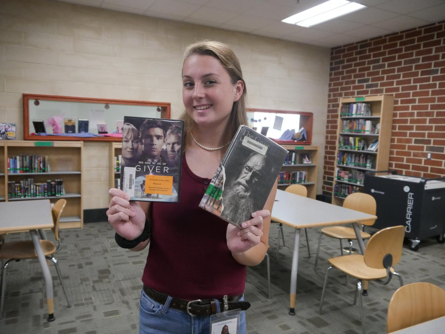 Alison Sawyer posing with 'The Giver', both movie and book.