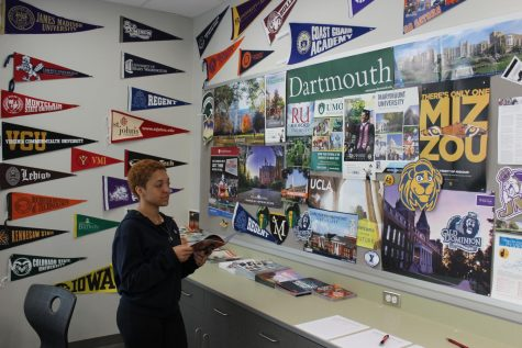 Senior Autumn Chambers looks for information on colleges in the College & Career Office.