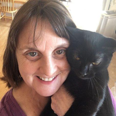 Victoria Zavadsky posing with her cat, Oscar