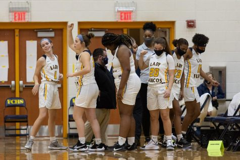 Members of the 2021 varsity Lady Flucos basketball team take a break during a Dec.  29 game at FCHS.