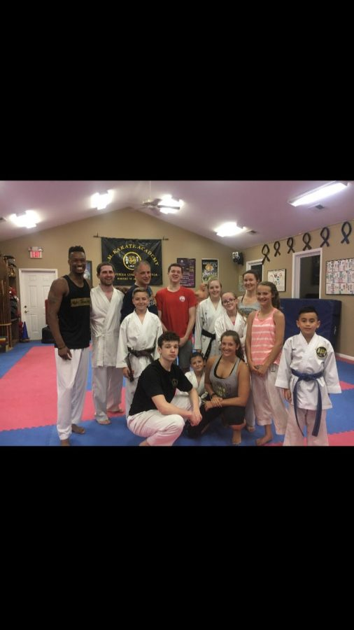 Blake Silverman, pictured in black tee in the front, with other students at LMKarate. Photo courtesy of Blake Silverman.