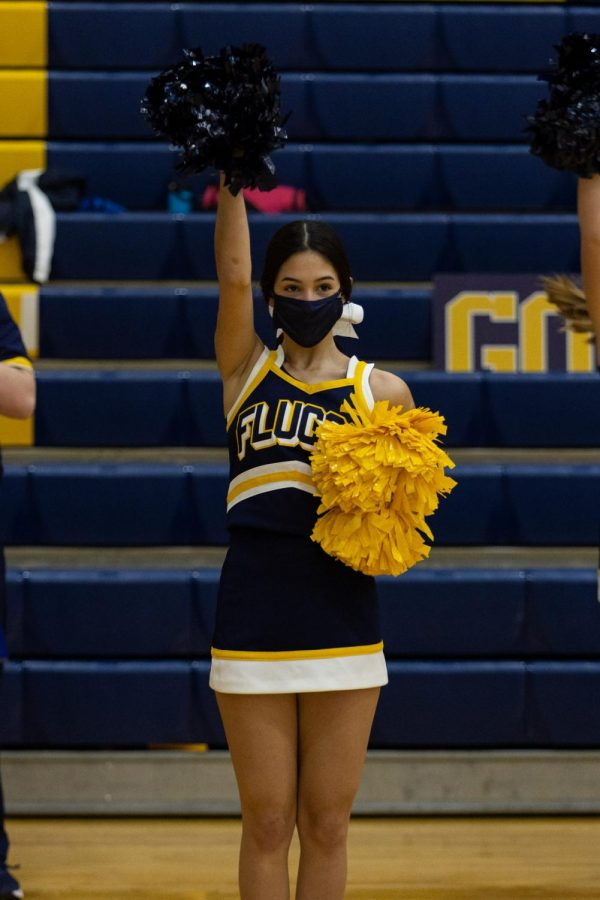 A Lady Fluco cheerleader cheers on boys basketball in Oct. 2020.