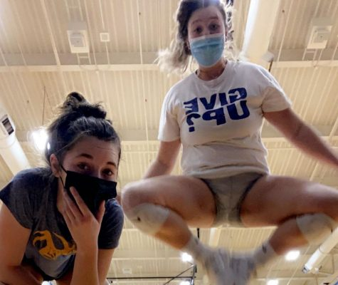 Two Lady Fluco volleyball players find fun in a world with masks.