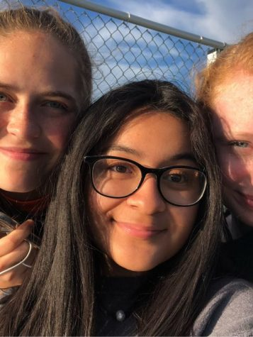 Girls soccer manager Paola Gomez Melgares (center) with players RIley Yowell and Sydney Forren.